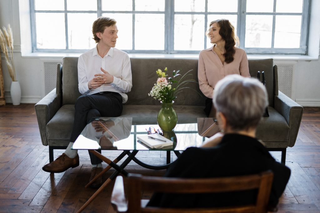 Couple talking to another person across the table